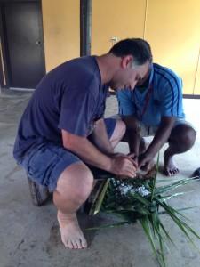 Paul grates coconut.